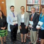 Finance society donates key study material to library